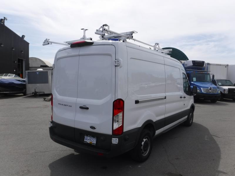 repocom  ford transit  cargo van medium roof   wb  ladder rack  shelving